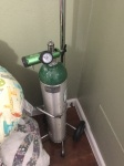 Back up oxygen tank in the corner of the room